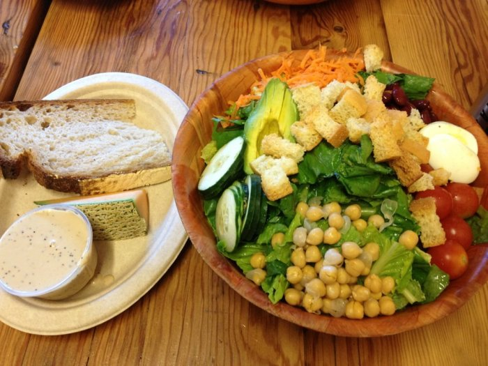 Half a Sweet Leaf Salad with a side of bread and fruit | Photo Courtesy of Cindy M. from Yelp