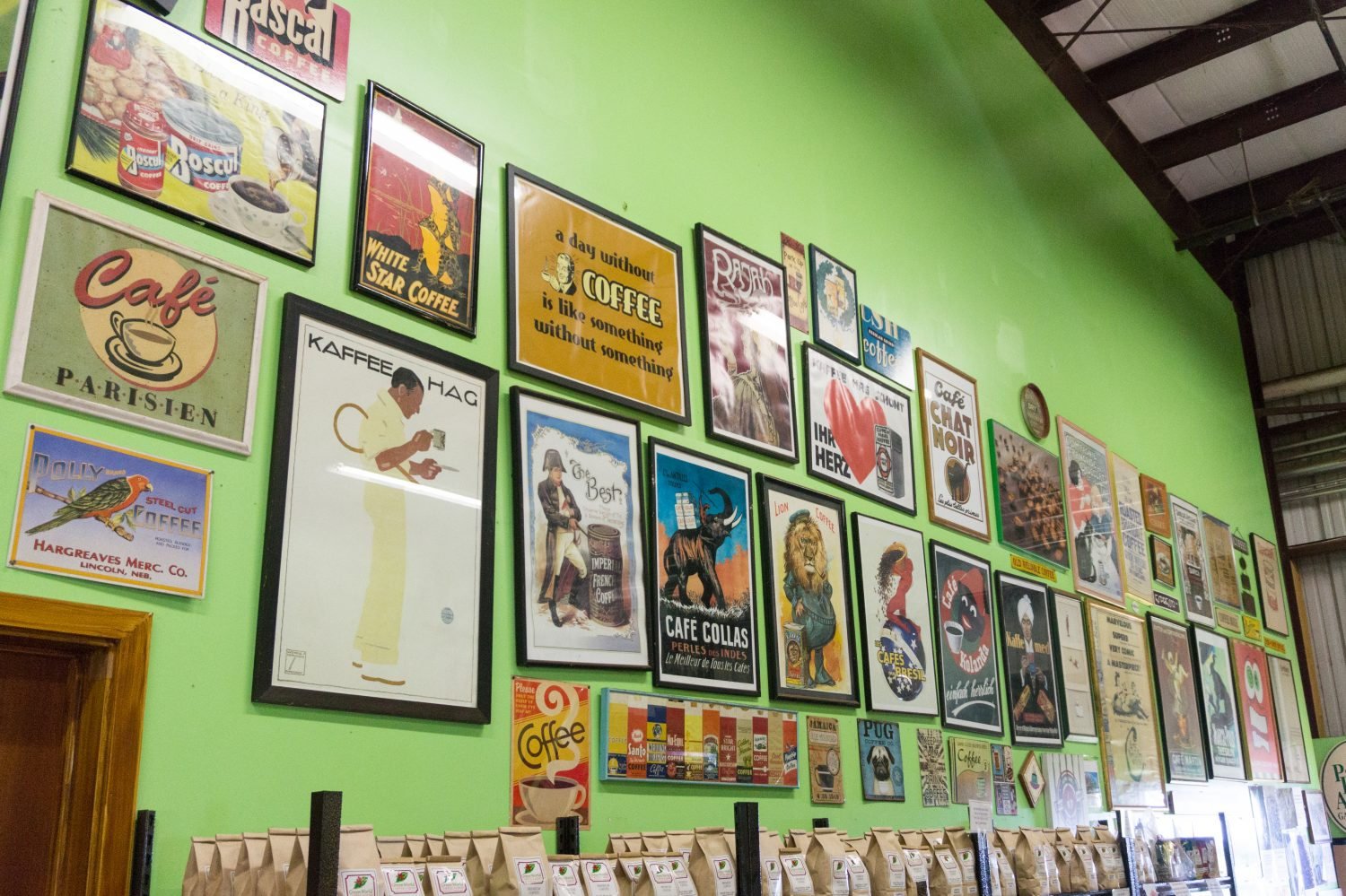 Green wall with framed coffee prints